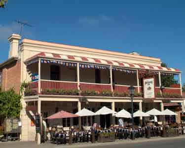 The Hhndorf Inn, Hahndorf, front view with umbrellas along the front.