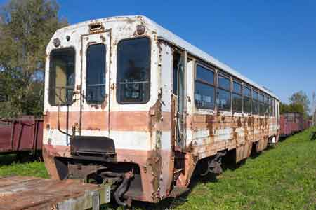 rusty old, whit and read railway carriage